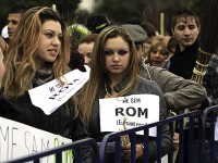 A member of a Roma non-governmental organization holds a poster during a protest against an initiative to change the term of Roma with Gypsy in Bucharest